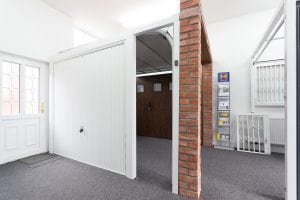 showroom with brown and white garage doors