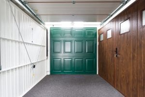 showroom with white, green and brown garage doors