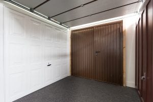 white panelled garage door and brown panelled garage doors