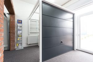 showroom with grey garage door