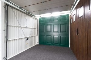 showroom with green, brown and white garage doors