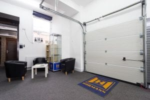 showroom with waiting area and white panelled roller door