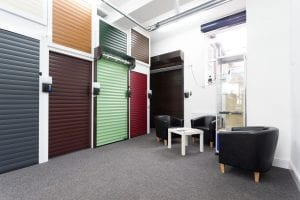 showroom with waiting area and various coloured roller shutter doors