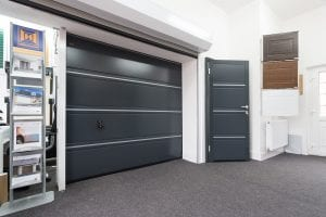 showroom with grey garage door, grey security door, brochures and door samples