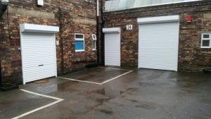 white shutter doors of different sizes