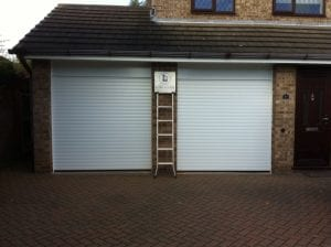 white electric roller garage doors