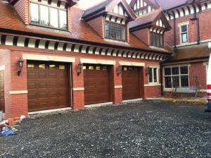 three brown sectional garage doors